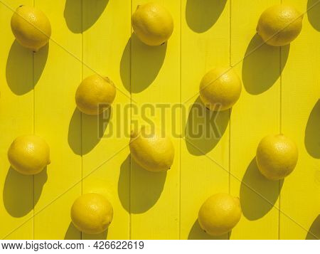 Ripe Lemons On The Yellow Wooden Surface, Top View. Vibrant Background