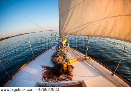 Travel On A Yacht. Girl Relaxes On The Ship. Rest On The Deck Of A White Yacht.