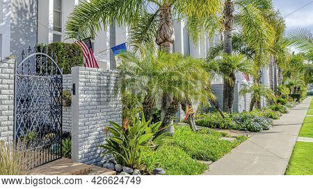 Pano Modern Townhomes With Landscaped Yards Stone Fence And Wrought Iron Gates