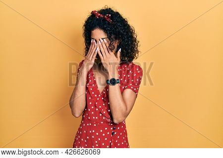 Young latin girl wearing summer dress rubbing eyes for fatigue and headache, sleepy and tired expression. vision problem