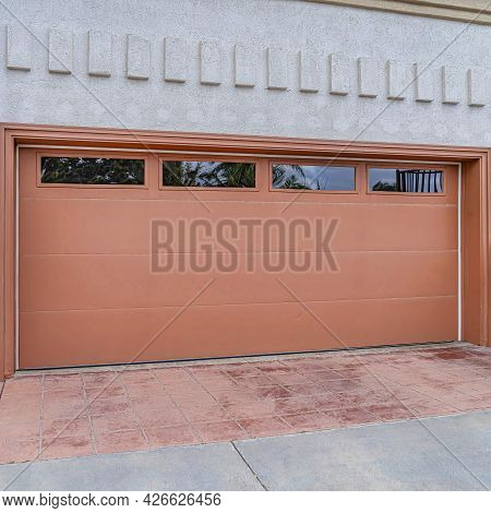Square Garage Of House In San Diego California With Glass Panes On The Wide Brown Door