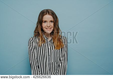 Lovely Young Female Dressed Casually With Long Hair Looking Positively At Camera, Studio Shot Of Cut