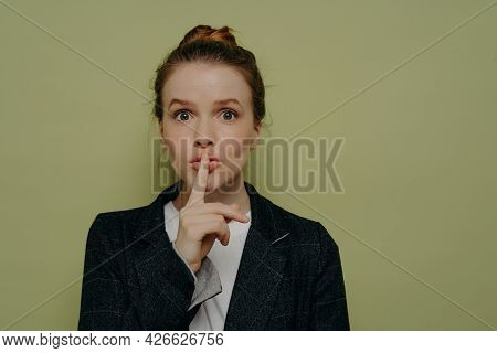 Mysterious Young Woman In Casual Wear Asking To Be Quiet Or Keep Something In Secret, Young Female M