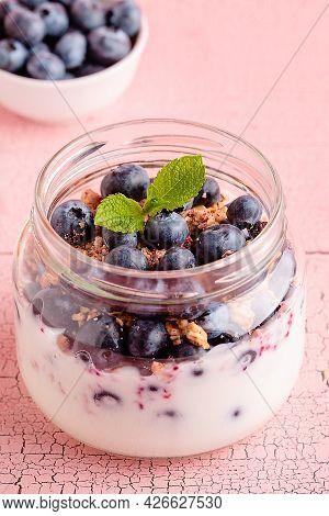Healthy Breakfast. Granola / Muesli Yoghurt And Fruit Served In Glass Jars.
