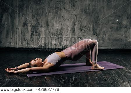 Muscular Young Athletic Woman With Perfect Beautiful Body Wearing Sportswear Doing Bridge Position L
