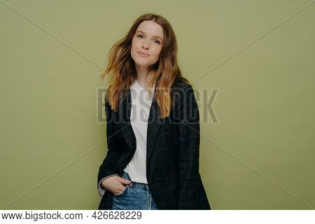 Stylish Nice Looking Young Female Student Wearing Fashionable Clothes Posing With Hand In Pocket On