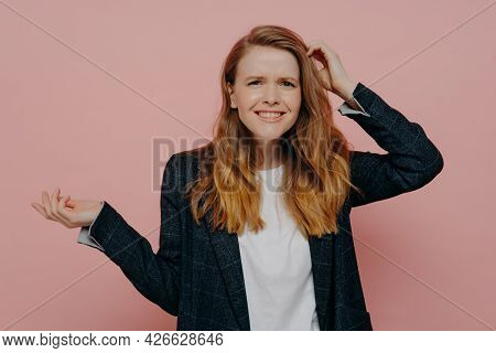 It Can Not Be True. Portrait Of Young Frustrated Woman Touching Head With Confused Expression, Can N
