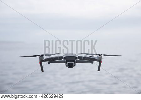 Cornwall, Uk - June 29, 2021.  A Dji Mavic Pro 2 Unmanned Drone Flying Above Water And Facing The Ca