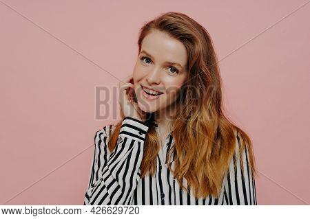 Natural Beauty. Charming Shy Teenage Girl Wearing Shirt Holding Hand Near Face And Smiling Flirty At