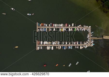 Aerial View Of A The Jetty Of A Sailing Club In Helford, Cornwall Full Of Small Boats