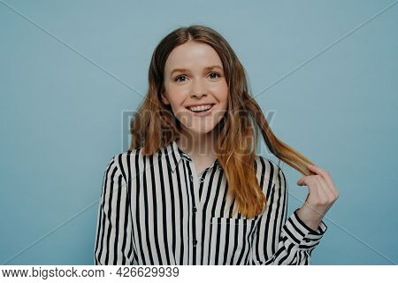 Positive Smiling Young Girl In Stripy Black And White Blouse Demonstrating Curiosity And Amusement W
