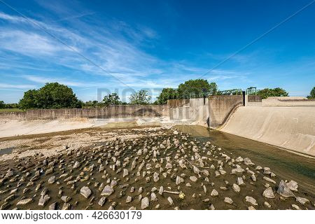 Reinforced Concrete Irrigation Canal With Dam Of The River Mincio In The Padan Plain Or Po Valley (p