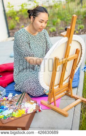 Asian Young Woman Painting Picture Of Lemons On Blue Blanket In Home Terrace. High Quality Photo
