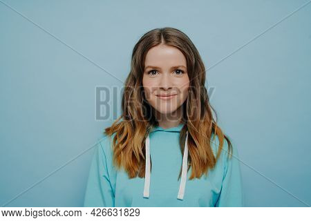 Portrait Of Teenager Girl With Wavy Ombre Hairstyle Smiling While Looking At Camera In Comfortable C