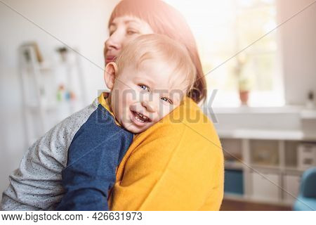 Happy Mother Embracing Her Smiling Son Carefully
