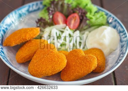 Chicken Nuggets With Salad In A Restaurant Of Malaysia