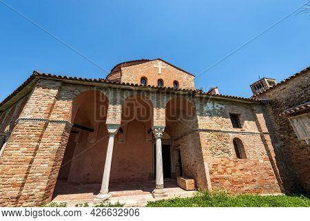 Facade Of The Church Of Santa Fosca (ix-xii Century) In Torcello Island In Venetian-byzantine Style,