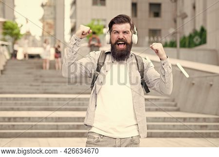 Listening Music. Handsome Hipster With Backpack. Good Sound. Energy Concept. Joy And Positivity. Rou