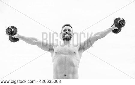 Power And Balance. Fitness And Sport Equipment. Muscular Man Exercising In Morning With Barbell. Ath