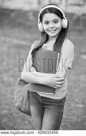Beginning Of School Year. Teen Girl Listen Audio Book. Child With Notebook In Schoolyard. Happy Kid