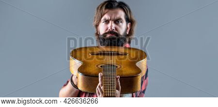 Music Concept. Bearded Guitarist Plays. Play The Guitar. Guitars And Strings. Bearded Man Playing Gu