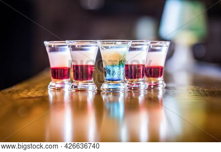 Colorful Shots At The Club. Alcoholic Drink In Different Colors. Shots At The Bar Table. Alcoholic D