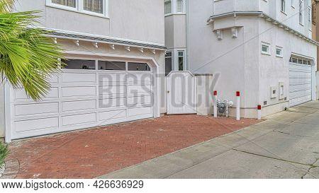 Pano Beautiful Homes Exterior In Long Beach California With Glass Paned Garage Doors