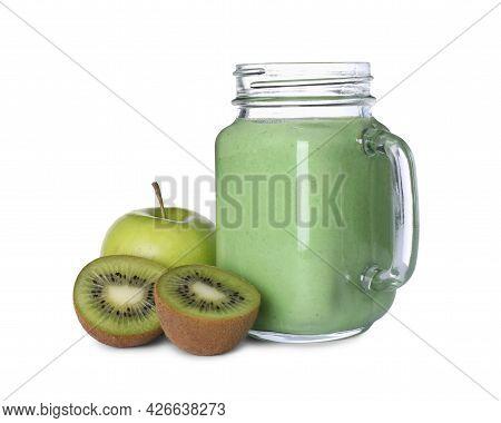 Tasty Fresh Green Smoothie In Mason Jar Near Ingredients On White Background