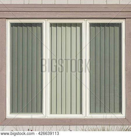 Square Window With Three Glass Panes At House Exterior In Huntington Beach California