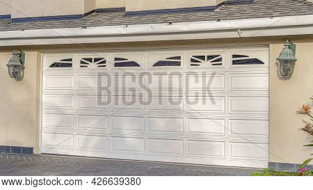 Pano Attached Garage With White Doors And Decorative Glass Panes In Huntington Beach
