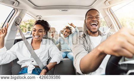 Happy Black Family Of Three Singing Having Fun Riding Car