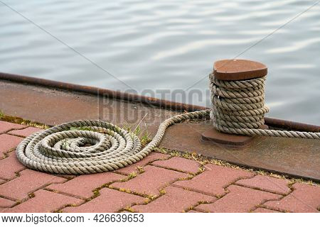 Bollard And Mooring Rope From A Moored Ship On The Mittellandkanal Near Magdeburg In Germany