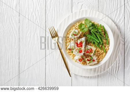 Cod With Bulgur, Steamed Green Beans, Sprinkled With Hot Chili Peppers And Spring Onions In A White