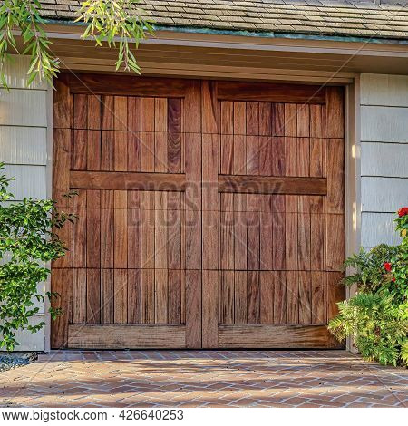 Square Facade Of Garage With Wooden Hinged Door And Gable Roof In San Diego California