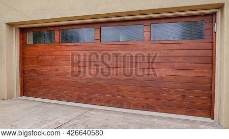Pano Wood Door With Glass Panes Of Attached Garage In San Diego California House
