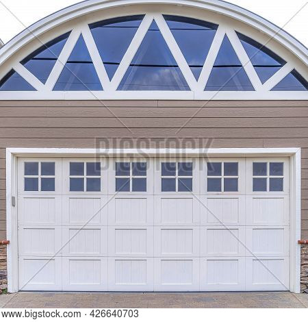 Square Garage Of Home In San Diego California With Arched Roof And Glass Paned Door