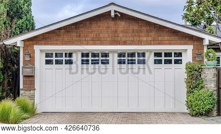 Pano Garage In San Diego California With White Door And Brown Wall Under Gable Roof