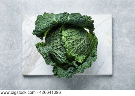 Fresh Ripe Savoy Cabbage On Grey Table, Top View