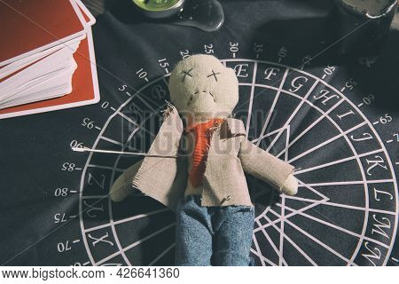 Voodoo Doll Pierced With Needle On Table. Curse Ceremony