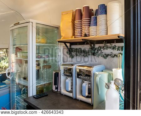 Coffee Stall On Wheels. Coffee Kiosk In Van. Glass Transparent Refrigerator And Coffee Makers. Dispo