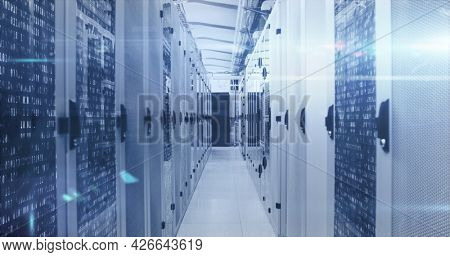 Image of data processing and digital information over network of computer servers with white light trails flashing. global network of internet service provider, data processing centre concept.