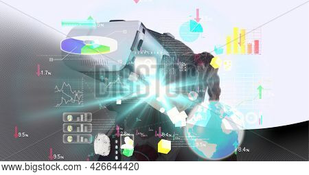 Data processing over caucasian girl wearing vr headset against grey technology background. computer interface and education technology concept