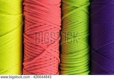 Colored Macrame Yarn Background. Skeins Of Cotton Yarn For Macrame Knitting