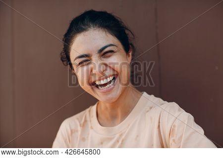 Portrait Of Beautiful Indian American Joyful Optimistic Positive Woman Laughing