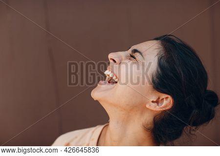 Portrait Of Beautiful Indian American Joyful Optimistic Positive Woman Laughing Profile View