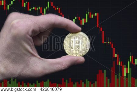 Man Hand Holding A Bitcoin Btc Crypto Currency Gold Coin With Global Trading Exchange Market Price G