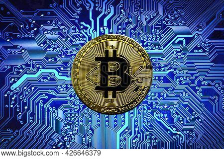 Bitcoin Btc Crypto Currency Gold Coins On A Mainboard, New Virtual Money Concept. Mining Or Blockcha