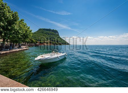 Lakeside And Beautiful Bay In Front Of The Small Town Of Garda, Tourist Resort On The Coast Of Lake