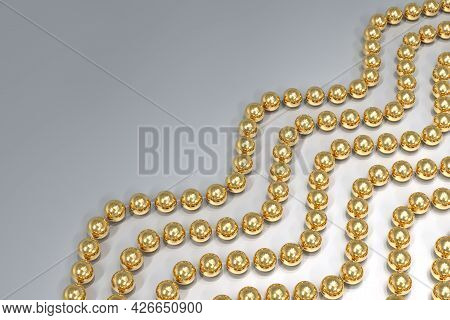 Background Of Strands Of Gold Beads On Transparent Fishing Line. The Beads Are Arranged Diagonally.