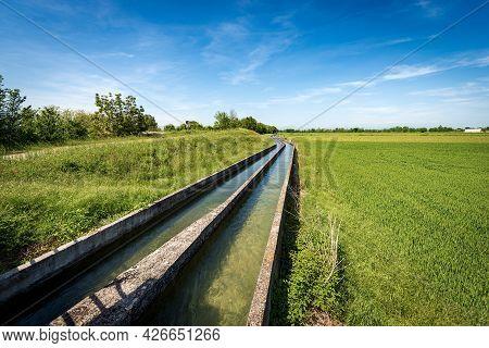 Two Small Concrete Irrigation Canals In A Rural Scene, Padan Plain Or Po Valley (pianura Padana, Ita